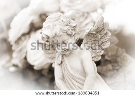 little Angel on a cemetery / Cemetery - stock photo