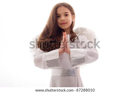 Little Angel Praying Gratefully Over White Background - stock photo