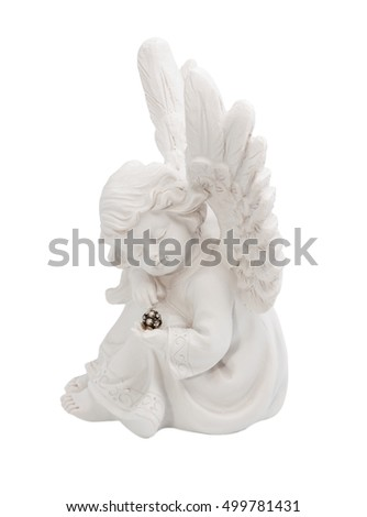 Little angel sitting and holding a precious stone on a white background