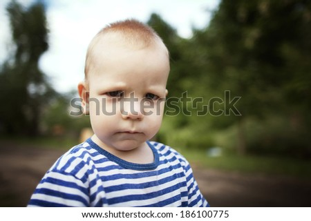 little angry boy portrait - stock photo