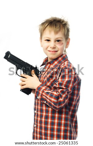 little angry boy with a bruise under his eye holding a gun