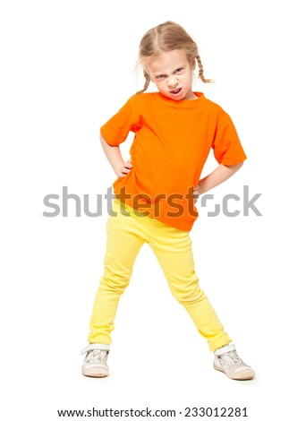 Little angry girl at yellow jeans. Child on white background - stock photo