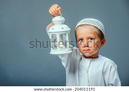 Little Arabian boy portrait  with candle in hand. - stock photo