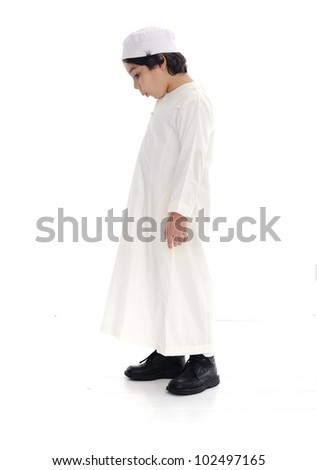 Little arabic boy isolated, looking up and down - stock photo
