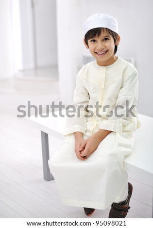 Little Arabic kid indoor - stock photo