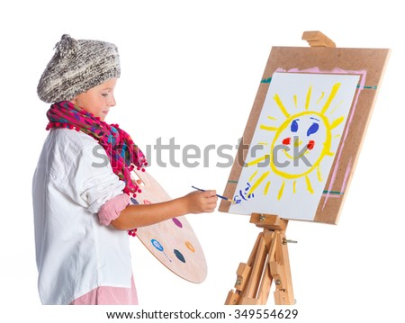 Little artist. Cute boy with watercolor painting, easel and palette, isolated on white background - stock photo