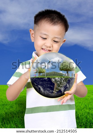Little asia boy holding the earth, (Knowledge concept),  Earth globe image provided by NASA - stock photo