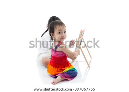 Little Asian artist child drawing  on white background