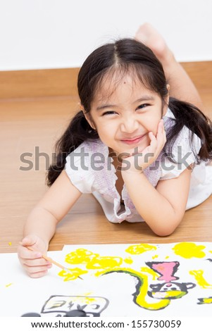 Little Asian artist girl drawing and painting  - stock photo