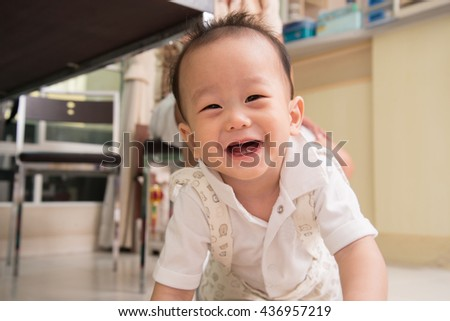 Little asian baby boy smiling with happy face - stock photo
