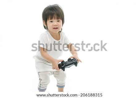 Little asian baby using video game controller. Isolated on white background - stock photo