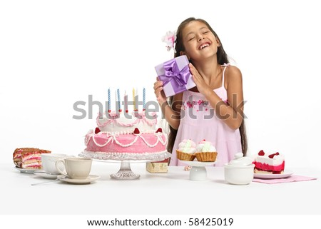 Little Asian beautiful girl celebrate her birthday, taking a present - stock photo