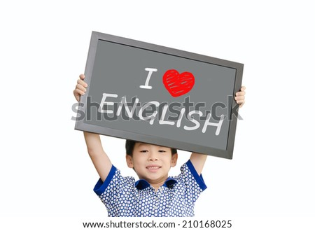 "Little Asian boy holding chalkboard with message ""I love English"" - stock photo"