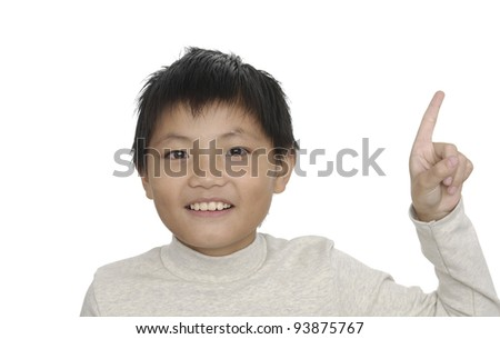 Little asian boy in round spectacles raising finger in funny attention gesture - stock photo