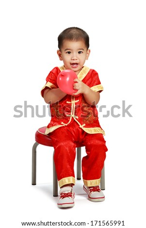 Little asian boy in traditional chinese cheongsam, Isolated over white