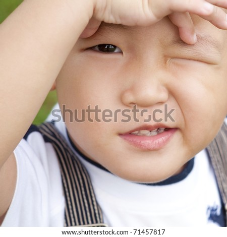 Little Asian boy is confusing, close up face. - stock photo
