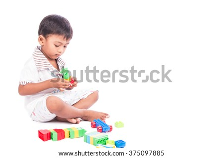 little asian boy play building brick