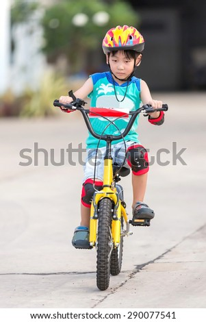 little asian boy ride the bicycle
