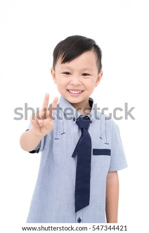 Little asian boy smiles over white background