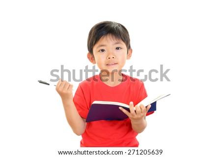 Little Asian boy studying - stock photo