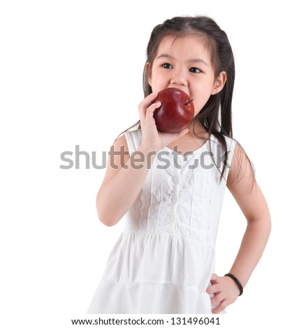 Little Asian child eating an apple on white background - stock photo