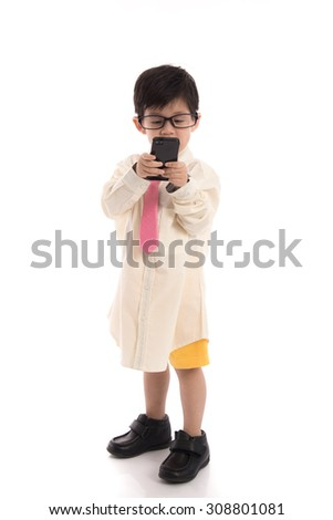 Little asian child pretending to be  businessman using smart phone on white background isolated - stock photo