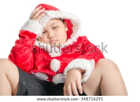 Little Asian fat boy in santa costume waiting for Christmas presents isolated - stock photo
