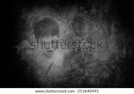 Little Asian ghost in the old wall - stock photo