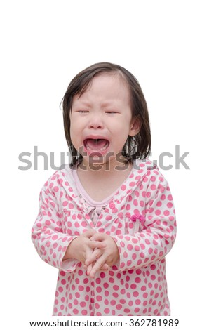 Little asian girl crying over white background