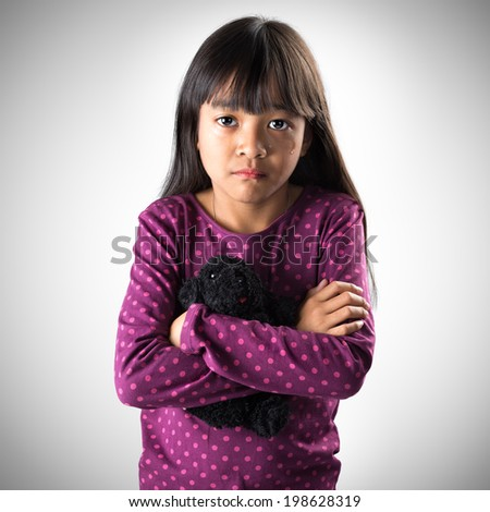 Little asian girl crying with tears rolling down her cheeks, Isolated on grey background - stock photo