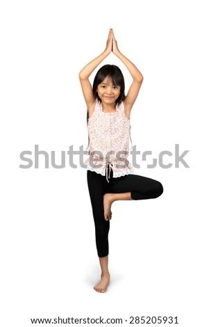 Little asian girl doing yoga exercises, Isolated over white - stock photo