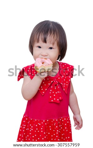 Little Asian girl eating donut over white