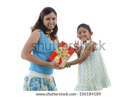 Little Asian girl giving gift for mother - stock photo
