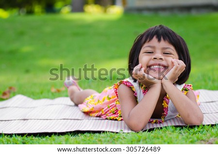 Little Asian Girl happy relax in the park - stock photo
