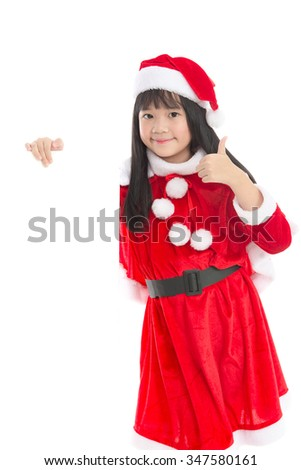 Little asian girl in  in Santa Claus  uniform with an empty banner, isolated on white
