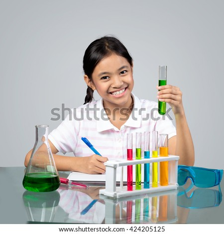Little asian girl is making science experiments education, science and chemical education concept.