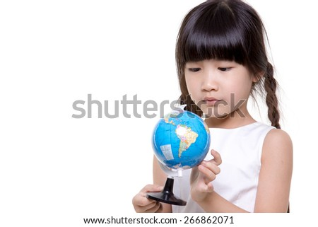 Little Asian girl looking and holding the globe