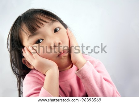Little asian girl looking for some idea