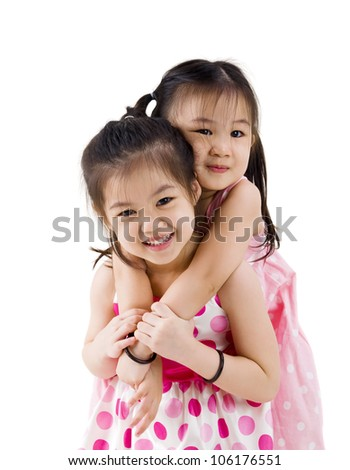 little asian girl piggyback her sister - stock photo