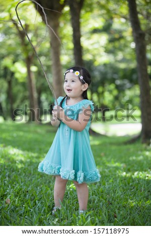 Little asian girl playing the branch - stock photo