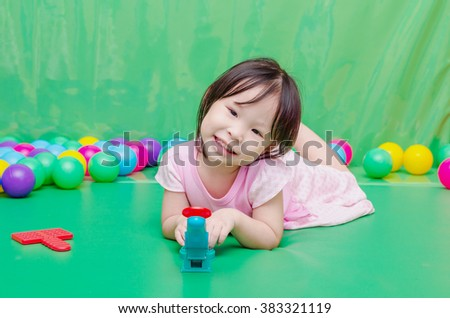Little Asian girl playing toy at school