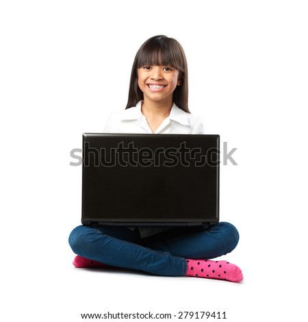 Little asian girl sitting on a floor with her laptop, Isolated over white