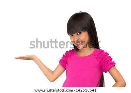 Little asian girl standing with her hand up against white background place your product here - stock photo