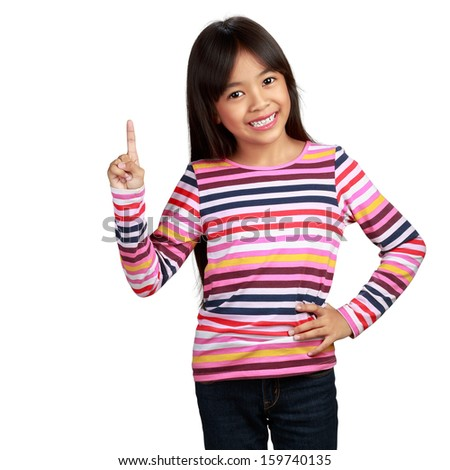 Little asian girl standing with index finger up, isolated over white with clipping path - stock photo
