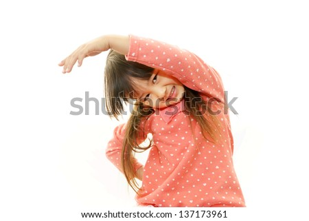 Little Asian girl stretching - stock photo