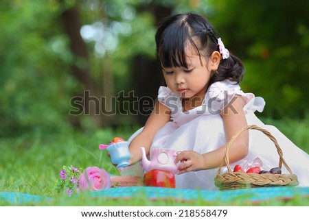 Little asian girl was playing happily in the park - stock photo