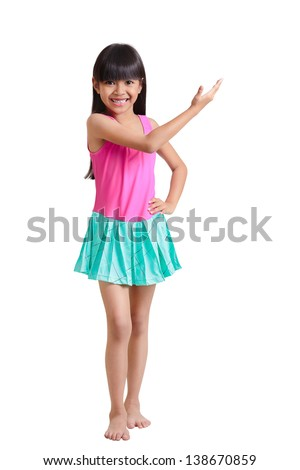 Little asian girl wearing swimsuit, Isolated over white with clipping path - stock photo