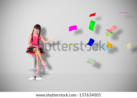 Little asian girl with a lot of flying papers - stock photo