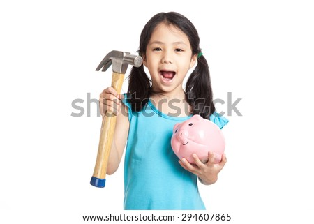 Little asian girl with hammer and piggy bank  isolated on white background