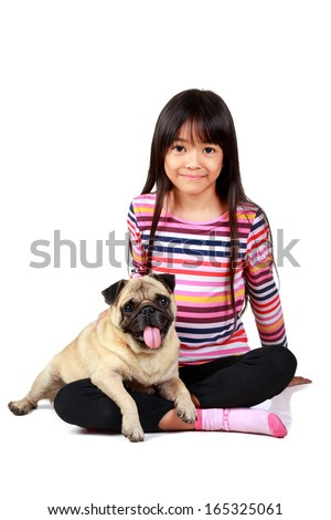 Little asian girl with her little pug, Isolated on white background - stock photo
